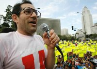 United states Apparel owner Dov Charney talks during a May Day rally protest march for immigrant legal rights.